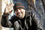 FILE - In this Nov. 11, 2014, file photo, rapper Ice-T waves to crowds from a float honoring retired military service animals during the 2014 annual Veterans Day parade in New York. Ice-T says there is no one he's rooting for in Sunday's, Aug. 23, 2020, Indianapolis 500 like pole sitter Marco Andretti. The unlikely friends have been tight for close to a decade. (AP Photo/Kathy Willens, File)