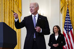 Vice President Kamala Harris watches as President Joe Biden takes a question from a reporter after speaking about distribution of COVID-19 vaccines, in the East Room of the White House, Monday, May 17, 2021, in Washington. (AP Photo/Evan Vucci)
