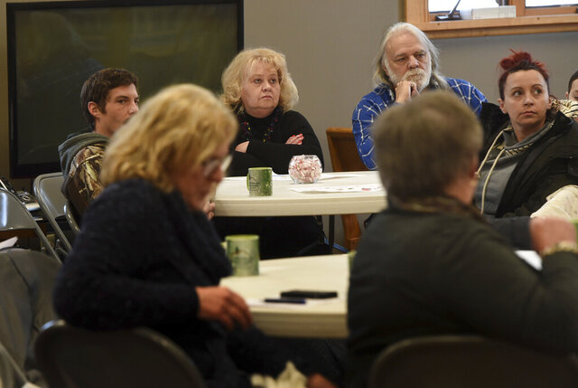 Cheryl and William Gackstetter, center, listen during a congregation meeting to discuss impending changes to the membership of The Grove United Methodist Church in Cottage Grove, Minn. on Sunday, Jan. 12, 2020. The church, seeking to attract more young families, will close for several months later this year. Current members, most of them over 60 years old, will be invited to worship somewhere else when the church reopens. (Scott Takushi/Pioneer Press via AP)