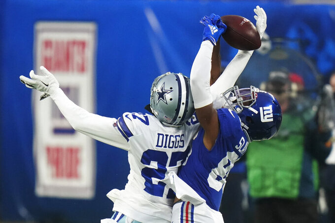 Dallas Cowboys' Trevon Diggs, left, and New York Giants' Darius Slayton fight for the ball during the second half of an NFL football game, Sunday, Jan. 3, 2021, in East Rutherford, N.J. (AP Photo/Frank Franklin II)