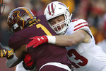 File-This Nov. 25, 2017, file photo shows Wisconsin inside linebacker Ryan Connelly (43) tackling Minnesota running back Rodney Smith (1) during an NCAA college football game in Minneapolis. Wisconsin's typically rugged defense is getting a makeover on the edges, with new starters at cornerback, outside linebacker and defensive end. Linebackers T.J. Edwards and Connelly help form an experienced core inside.  (AP Photo/Stacy Bengs, File)