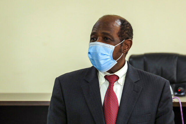 Paul Rusesabagina appears in front of media at the headquarters of the Rwanda Bureau of investigations building in Kigali, Rwanda Monday, Aug. 31, 2020. Rusesabagina, who was portrayed in the film