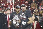 San Francisco 49ers quarterback Jimmy Garoppolo (10) and tight end George Kittle (85) enjoy a confetti celebration after the NFL NFC Championship football game against the Green Bay Packers, Sunday, Jan. 19, 2020 in Santa Clara, Calif. (Margaret Bowles via AP)