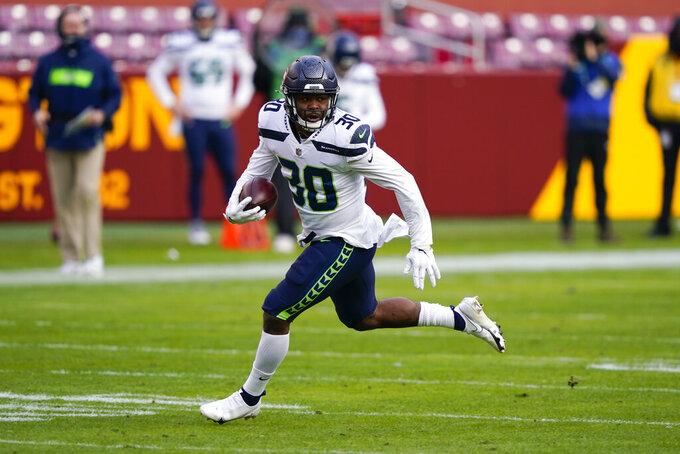 Seattle Seahawks running back Carlos Hyde (30) carries the ball during his 50-yard touchdown run against the Washington Football Team, Sunday, Dec. 20, 2020, in Landover, Md. (AP Photo/Susan Walsh)