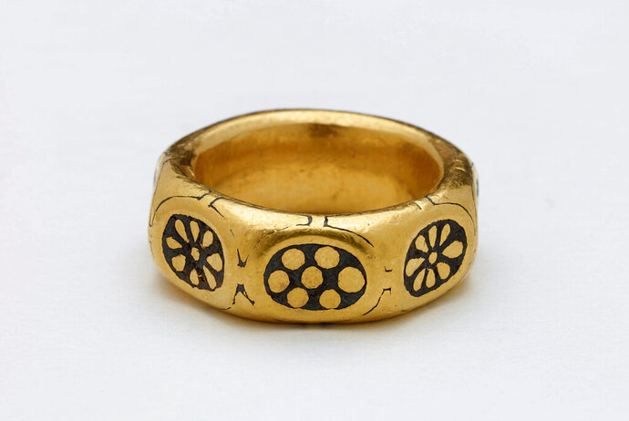 This undated handout photo provided by the British Museum shows a gold ring from the ninth century which was part of a £3 million Viking hoard, metal detectorists George Powell and Layton Davies have been convicted of stealing. Two amateur British treasure-hunters have on Friday, Nov. 22, 2019 been imprisoned for stealing a hoard of 1,100-year-old Anglo-Saxon coins and jewelry valued at millions of pounds. Experts say the hoard, much of which is still missing, could shed new light on a period when Saxons were battling Vikings for control of England. (British Museum via AP)