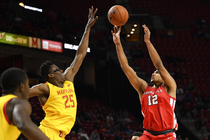 Fairfield forward Kevin Senghore-Peterson (12) shoots against Maryland forward Jalen Smith (25) during the first half of an NCAA college basketball game, Tuesday, Nov. 19, 2019, in College Park, Md. (AP Photo/Nick Wass)