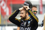 FILE - In this July 12, 2019, file photo, Canadian race car driver James Hinchcliffe gets ready to take part in the first of two practice sessions at the IndyCar auto race in Toronto. Sebastien Bourdais spent a day in early November helping IndyCar fine-tune its newest safety innovation. Later that night, he learned he was likely losing his job with a year remaining on his contract. The four-time series champion joined James Hinchcliffe as veterans abruptly dumped from their rides as IndyCar is shifting toward younger, cheaper drivers. (Andrew Lahodynskyj/The Canadian Press via AP, File)