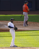 New York Yankees relief pitcher Aroldis Chapman, left, reacts after striking out Baltimore Orioles' Pat Valaika (74) to close the ninth inning of a baseball game, Saturday, Sept. 12, 2020, in New York. (AP Photo/John Minchillo)
