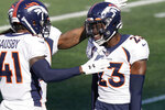 Denver Broncos cornerback Michael Ojemudia, right, is congratulated by De'Vante Bausby, left, after he forced a New England Patriots fumble in the second half of an NFL football game, Sunday, Oct. 18, 2020, in Foxborough, Mass. (AP Photo/Steven Senne)