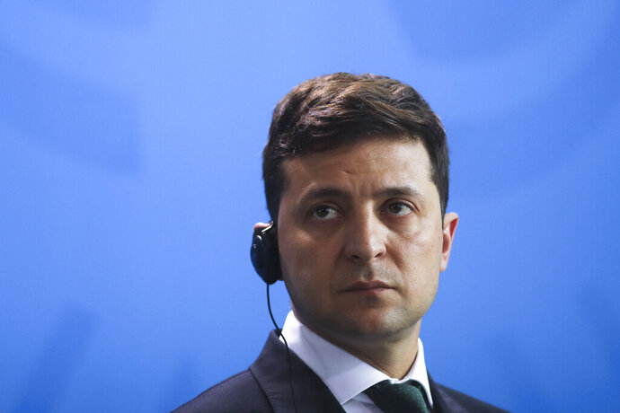 Ukrainian President Volodymyr Zelenskiy attends a joint news conference with German Chancellor Angela Merkel after a meeting at the chancellery in Berlin, Germany, Tuesday, June 18, 2019. (AP Photo/Markus Schreiber)