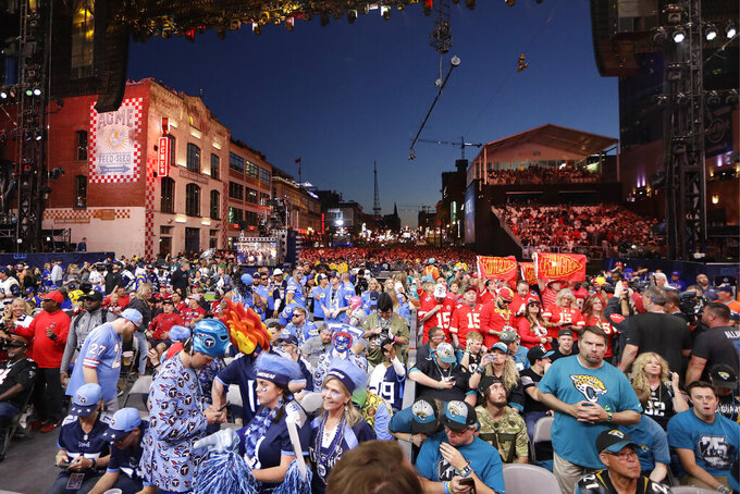 Fans sit on the main stage during the second round of the NFL football draft, Friday, April 26, 2019, in Nashville, Tenn. (AP Photo/Mark Humphrey)