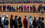 FILE — In this May 20, 2020 file photo, people affected by the coronavirus economic downturn line up to receive food parcels in Pretoria, South Africa, South Africa's economy is expected to decline by 7.2% this year, its worst performance in 90 years, as the coronavirus pandemic takes a toll on sub-Saharan Africa's most developed country. (AP Photo/Themba Hadebe/File)
