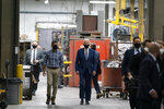 Democratic presidential candidate former Vice President Joe Biden tours the Wisconsin Aluminum Foundry with Sachin Shivaram, CEO of Wisconsin Aluminum Foundry, in Manitowoc, Wis., Monday, Sept. 21, 2020. (AP Photo/Carolyn Kaster)