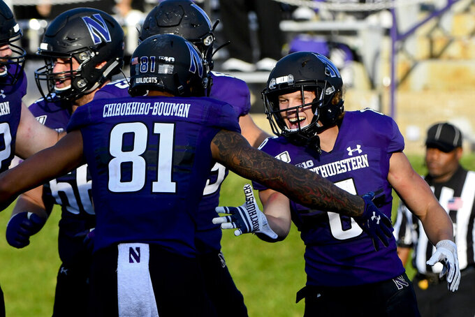 Northwestern running back Drake Anderson, right, celebrates with Northwestern wide receiver Ramaud Chiaokhiao-Bowman (81) after Anderson scored a touchdown against UNLV during the second half of an NCAA college football game, Saturday, Sept. 14, 2019, in Evanston, Ill. (AP Photo/Matt Marton)
