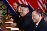 """FILE - In this Feb. 28, 2019, file photo, North Korean leader Kim Jong Un smiles during a meeting with President Donald Trump, Thursday, Feb. 28, 2019, in Hanoi. at right is Kim Yong Chol, a North Korean senior ruling party official and former intelligence chief. North Korea on Wednesday, Aug. 11, 2021, repeated a threat to respond to U.S.-South Korean military exercises it claims are an invasion rehearsal, while the United States insisted the drills were """"purely defensive in nature"""" to maintain the South's security. (AP Photo/ Evan Vucci, File)"""