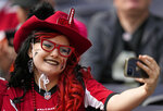 A Falcons fan takes a selfie before an NFL football game between the New York Jets and the Atlanta Falcons at the Tottenham Hotspur stadium in London, England, Sunday, Oct. 10, 2021. (AP Photo/Alastair Grant)