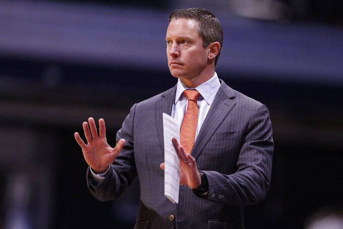 Florida head coach Mike White gestures on the sideline as his team play against Butler in the first half of an NCAA college basketball game in Indianapolis, Saturday, Dec. 7, 2019. (AP Photo/Michael Conroy)