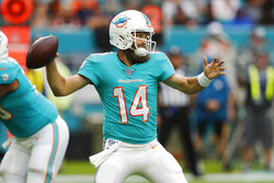 Miami Dolphins quarterback Ryan Fitzpatrick (14) looks to pass, during the first half at an NFL football gam against the Cincinnati Bengals, Sunday, Dec. 22, 2019, in Miami Gardens, Fla. (AP Photo/Brynn Anderson)