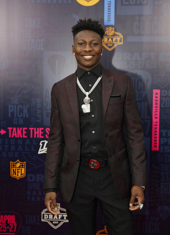 Oklahoma wide receiver Marquise Brown walks the red carpet ahead of the first round at the NFL football draft, Thursday, April 25, 2019, in Nashville, Tenn. (AP Photo/Mark Humphrey)