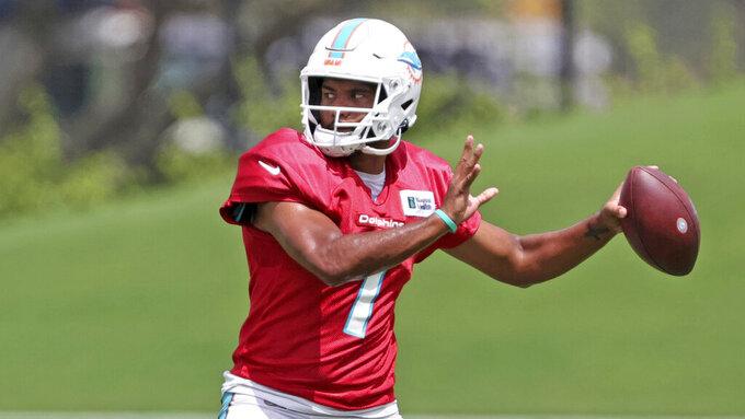 Miami Dolphins quarterback Tua Tagovailoa (1) works a drill during NFL football practice, Wednesday, Sept. 1, 2021 in Miami Gardens, Fla. (David Santiago/Miami Herald via AP)