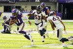 Minnesota Vikings quarterback Kellen Mond (11) scrambles up field ahead of Denver Broncos linebacker Jonathon Cooper (53) and linebacker Curtis Robinson (63) during the second half of an NFL preseason football game, Saturday, Aug. 14, 2021, in Minneapolis. (AP Photo/Jim Mone)