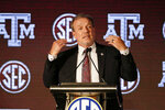FILE - In this July 21, 20121, file photo, Texas A & M head coach Jimbo Fisher speaks to reporters during the NCAA college football Southeastern Conference Media Days in Hoover, Ala. Fisher enters the fourth season of his massive $75 million contract at Texas A&M having elevated the Aggies to among the top programs in the country. Now the challenge for Fisher and the Aggies is to take the next step and contend for their first national title since 1939. (AP Photo/Butch Dill, File)