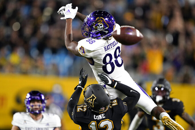 Appalachian State defensive back Madison Cone breaks up a pass intended for East Carolina wide receiver Jsi Hatfield during the second half of an NCAA college football game Thursday, Sept. 2, 2021, in Charlotte, N.C. (AP Photo/Chris Carlson)