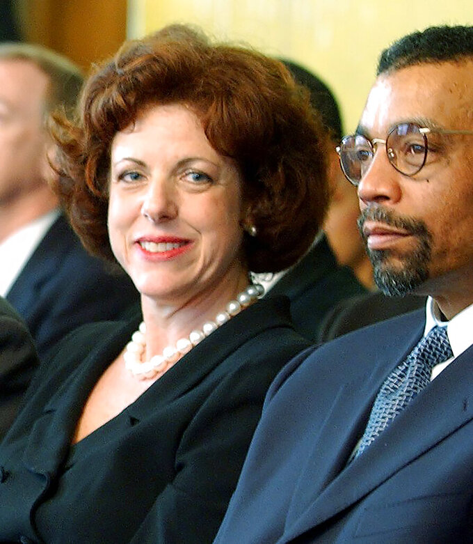 FILE - In this April 12, 2002, file photo U.S. District Judge Susan Dlott, left, sits with attorney Billy Martin in Cincinnati. Dlott lifted minority and female hiring quotas imposed on the Cincinnati police department 40 years ago to fix the department's lack of diversity. She said in a Wednesday, Sept. 15, 2021, ruling that the provisions put in place city in 1981 no longer pass constitutional muster. She also said Cincinnati has failed to provide any evidence that the race-based hiring and promotional goals are continuing to remedy past discrimination or its lingering effects. (Gary Landers/The Cincinnati Enquirer via AP, File)