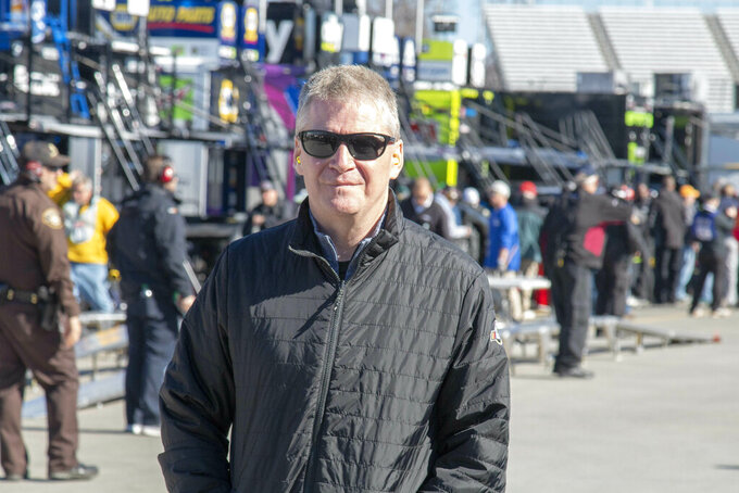 Retired NASCAR driver Jeff Burton visits the garage area during practice for the NASCAR Monster Energy Cup Series race at Martinsville Speedway in Martinsville, Va., Saturday, March 23, 2019. (AP Photo/Matt Bell)