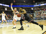 Gardner-Webb's DJ Laster (25) drives down the baseline against Virginia's Jack Salt (33) during a first-round game in the NCAA men's college basketball tournament in Columbia, S.C. Friday, March 22, 2019. (AP Photo/Richard Shiro)