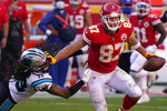 Kansas City Chiefs tight end Travis Kelce (87) runs against Carolina Panthers free safety Tre Boston (33) during the second half of an NFL football game in Kansas City, Mo., Sunday, Nov. 8, 2020. (AP Photo/Jeff Roberson)