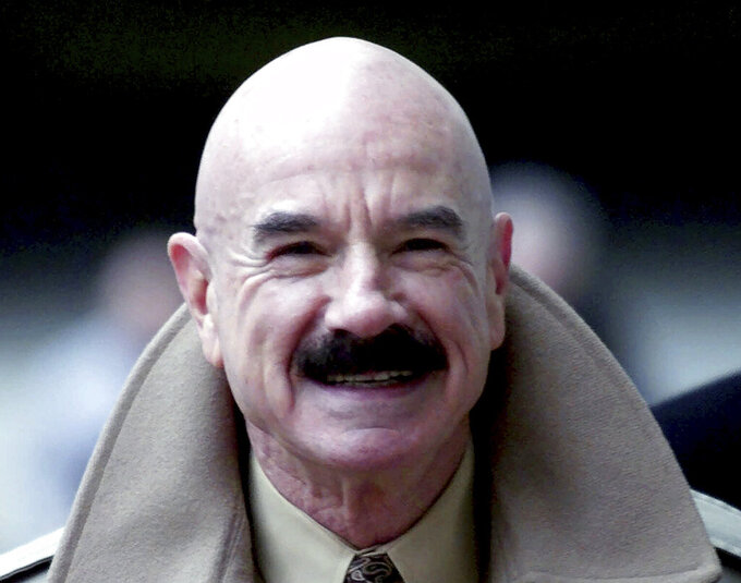 FILE - This Jan. 16, 2001, file photo shows G. Gordon Liddy, a Watergate conspirator, arriving at Baltimore's federal courthouse. Liddy, a mastermind of the Watergate burglary and a radio talk show host after emerging from prison, has died at age 90. His son, Thomas Liddy, confirmed the death Tuesday, March 30, 2021, but did not reveal the cause. (AP Photo/Roberto Borea, File)