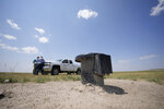 In this Monday, July 26, 2021, photograph, a well head is shown on the Terry Bison Ranch as Cole Gustafson, a water resource administrator for the Greeley, Colo., Water Department, works near his pickup truck near Carr, Colo.  Figures released this month show that population growth continues unabated in the South and West, even as temperatures rise and droughts become more common. That in turn has set off a scramble of growing intensity in places like Greeley to find water for the current population, let alone those expected to arrive in coming years. (AP Photo/David Zalubowski)