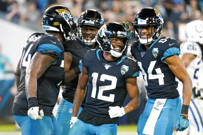 Jacksonville Jaguars wide receiver Dede Westbrook (12) celebrates a touchdown catch against the Indianapolis Colts during the second half of an NFL football game, Sunday, Dec. 29, 2019, in Jacksonville, Fla. (AP Photo/Stephen B. Morton)