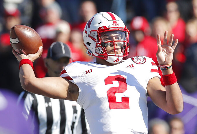 Nebraska's Adrian Martinez throws a pass against Northwestern during the first half of an NCAA college football game Saturday, Oct. 13, 2018, in Evanston, Ill. (AP Photo/Jim Young)