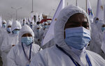Healthcare workers take part in a ceremony kicking off a door-to-door COVID-19 vaccination campaign, in El Alto, Bolivia, Thursday, Sept. 16, 2021. (AP Photo/Juan Karita)