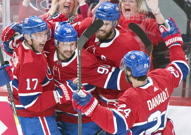 Montreal Canadiens' Ilya Kovalchuk (17) celebrates with teammates Tomas Tatar (90), Shea Weber (6) and Phillip Danault (24) after scoring against the Vegas Golden Knights during first-period NHL hockey game action in Montreal, Saturday, Jan. 18, 2020. (Graham Hughes/The Canadian Press via AP)
