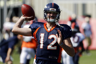 Broncos Lynch Throws Football
