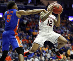 Auburn guard J'Von McCormick (12) drives against Florida guard KeVaughn Allen (5) in the second half of an NCAA college basketball game at the Southeastern Conference tournament Saturday, March 16, 2019, in Nashville, Tenn. Auburn won 65-62. (AP Photo/Mark Humphrey)
