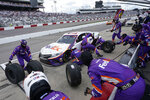 Denny Hamlin (11) gets service in the pits during the NASCAR Cup Series auto race at Richmond International Raceway in Richmond, Va., Sunday, April 18, 2021. (AP Photo/Steve Helber)