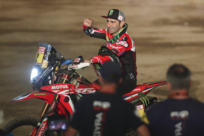 FILE - In this Sunday, Jan. 6, 2019 file photo, Paulo Gonçalves of Portugal rides his Honda motorbike during the podium ceremony before the start of the Dakar Rally in Lima, Peru. Gonçalves died in Saudi Arabia on Sunday Jan. 12, 2020 while taking part in his 13th Dakar rally (AP Photo/Martin Mejia, File)