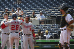 Washington Nationals' Patrick Corbin (46), Lane Thomas (28) and Adrian Sanchez (9) celebrate after Thomas hit a home run that scored them in the fourth inning during a baseball game against the Washington Nationals, Sunday, Sept. 12, 2021, in Pittsburgh. (AP Photo/Rebecca Droke)