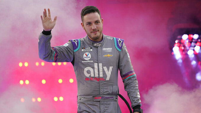 Alex Bowman waves to the crowd during driver introductions prior to the start of the NASCAR Cup series auto race in Richmond, Va., Saturday, Sept. 11, 2021. (AP Photo/Steve Helber)