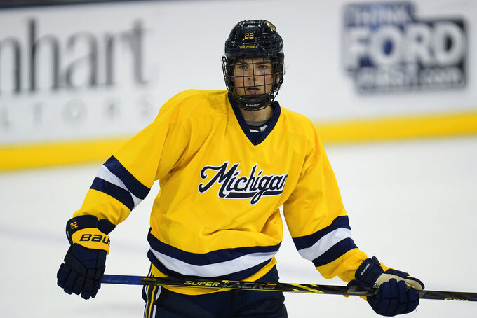 University of Michigan defenseman Owen Power skates during an NCAA college hockey practice in Ann Arbor, Mich., Wednesday, Sept. 22, 2021. Power passed on a chance to make millions this season with the Buffalo Sabres, who selected the defenseman overall in July. He decided to stay in school and return for his sophomore season with the Wolverines, ranked No. 3 in the preseason. (AP Photo/Paul Sancya)