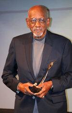 FILE - In this Nov. 16, 2013, file photo, Harrison Dillard, of the United States, holds his IAAF 2013 Hall of Fame award in Monaco. Dillard, the only Olympic runner to win gold medals in both the sprints and high hurdles, has died. He was 96. Longtime friend Ted Theodore said Dillard died Friday, Nov. 15, 2019, at the Cleveland Clinic after a fight with stomach cancer. The 1955 Sullivan Award winner as the nation's outstanding amateur athlete, Dillard was the oldest living U.S. Olympic champion. (AP Photo/Lionel Cironneau, File)