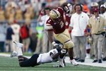 Wake Forest defensive back Nasir Greer, bottom, stops Boston College running back AJ Dillon (2) on the carry during the first half of an NCAA college football game in Boston, Saturday, Sept. 28, 2019. (AP Photo/Michael Dwyer)