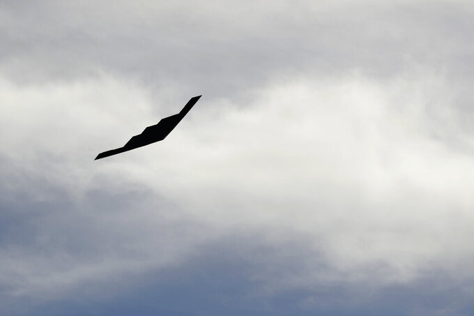 A B-2 stealth bomber flies over a NASCAR Cup Series auto race at Kansas Speedway in Kansas City, Kan. Sunday, Oct. 20, 2019. (AP Photo/Charlie Riedel)