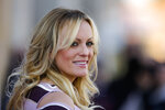 FILE - In this Oct. 11, 2018, file photo, adult film actress Stormy Daniels attends the opening of the adult entertainment fair 'Venus' in Berlin, Germany. Search warrants unsealed Thursday, July 18, 2019, shed new light on President Donald Trump's role as his campaign scrambled to respond to media inquiries about hush money paid to two women who said they had affairs with him. The investigation involved payments Trump's attorney Michael Cohen helped orchestrate to Daniels and Playboy centerfold Karen McDougal. (AP Photo/Markus Schreiber, File)