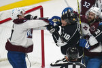 Colorado Avalanche left wing J.T. Compher, left, and Los Angeles Kings center Michael Amadio (10) fight during the first period of an NHL hockey game Thursday, Jan. 21, 2021, in Los Angeles. (AP Photo/Ashley Landis)