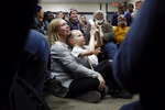 Attendees listen as Democratic presidential candidate Sen. Elizabeth Warren, D-Mass., speaks during a campaign event, Saturday, Jan. 18, 2020, in Des Moines, Iowa. (AP Photo/Patrick Semansky)